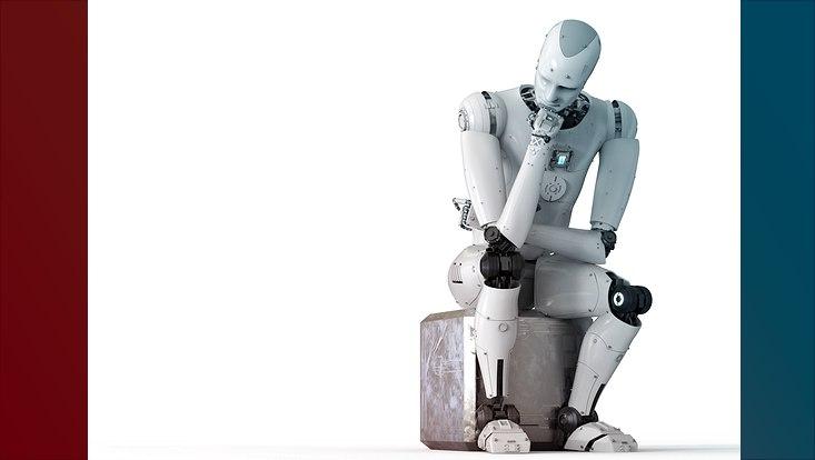 Ein Roboter sitzt auf einem Quader und scheint nachzudenken.