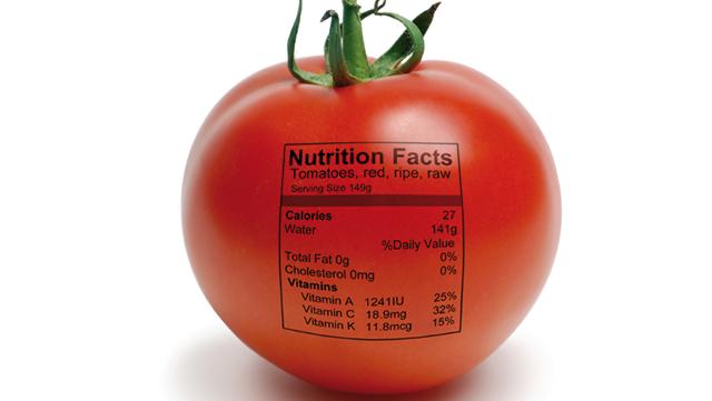 Tomate mit aufgedruckter Formel