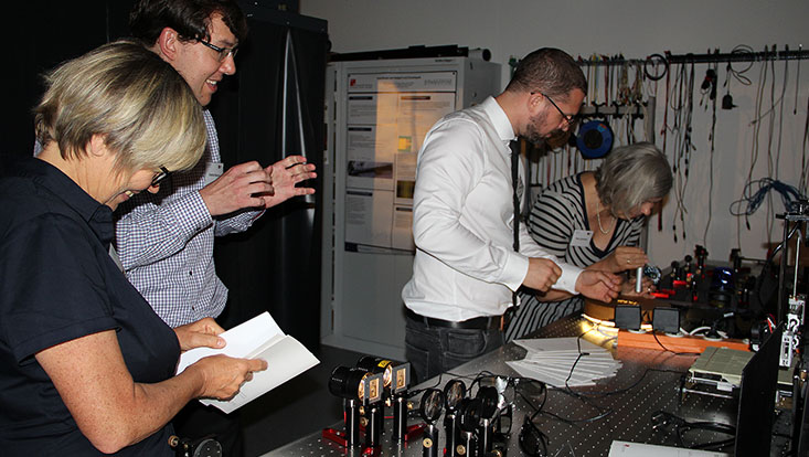 four people experimenting in the light and schools lab