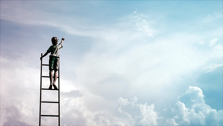 Child on ladder reaching for the sky