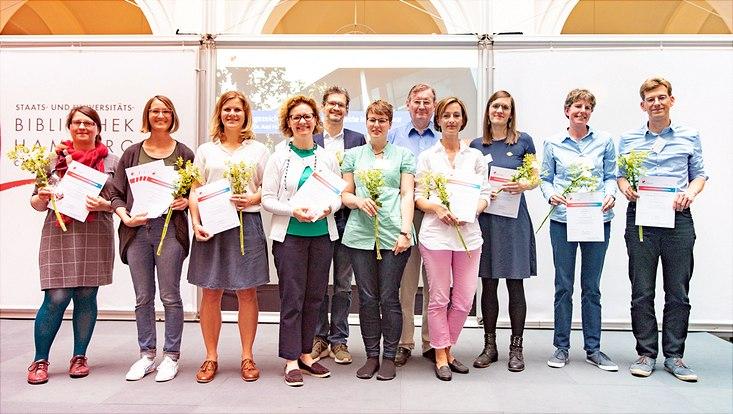 Elf ausgezeichnete Lehrprojekte aus sechs Fakultäten im Lehrlabor Universitätskolleg anlässlich der Jahrestagung am 27. Juni 2019 im Lichthof der Staats- und Universitätsbibliothek Hamburg Carl von Ossietzky