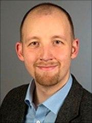 Dies ist ein Portrait von Christian Brettschneider.