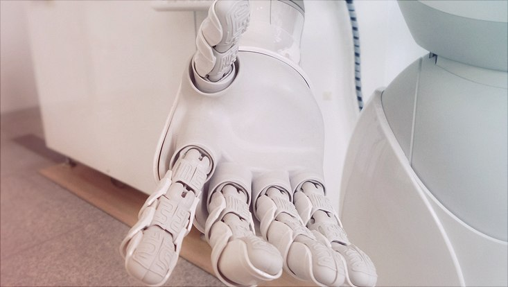 White robot hand reaching out to viewer