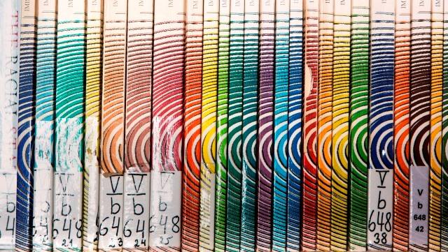 Buchrücken einiger Ausgaben von IMES Beiträge/Spines of some editions of IMES-Beiträge
