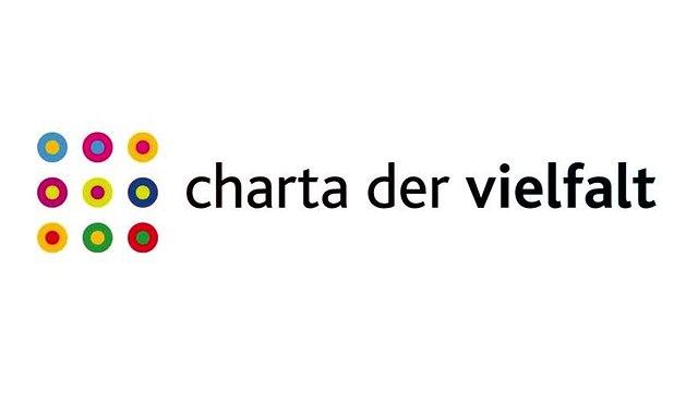 Das Logo der Charta der Vielfalt zeigt bunte, im Quadrat angeordnete Kreise
