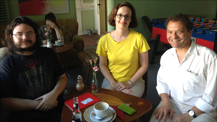 group foto of two men and one woman in a cafe-bar