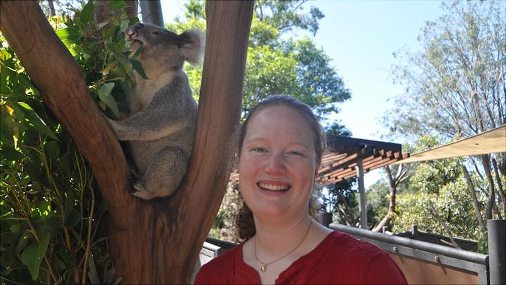 female student posing with a koala
