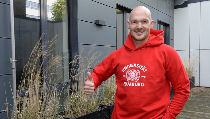 Alexander Gerst wearing Universität Hamburg hoody