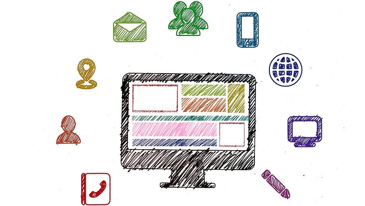 Computer mit Symbolen zum Thema Digitalisierung